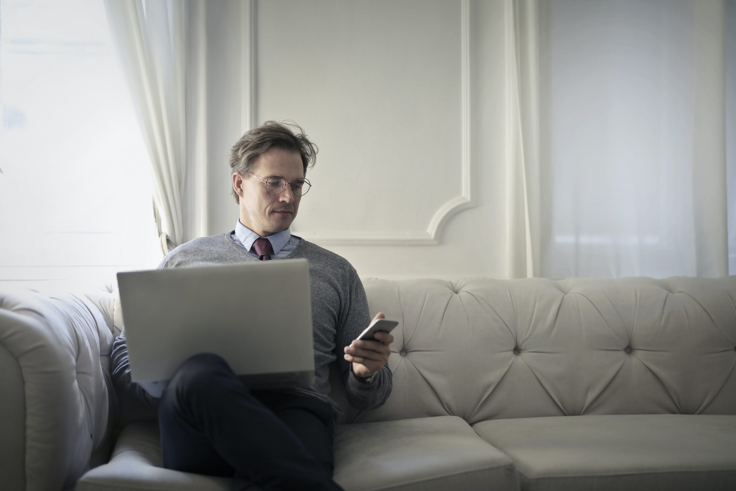 photo-of-a-man-using-laptop-and-cellular-phone-3771789-scaled.jpg